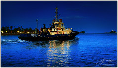 Shimmering Light (juliewilliams11) Tags: photoborder bluehour outdoor waterfront harbour vehicle vessel water boat tug sea landscape reflection newsouthwales newcastle australia blue sky night light