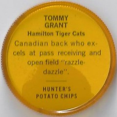 1963 Hunter's / Nalley's Potato Chips CFL Plastic Football Coin (golden yellow cap) - TOMMY GRANT #49-H (Hall of Fame 1995) (Hamilton Tiger Cats / Canadian Football League) (upgraded coin) (Treasures from the Past) Tags: 1963 cfl nalleys coins potatochips hunters krunchee humptydumpty nocompanyname nobrand canadianfootballleague nobrandbilingual bilingual football cap disc lownumber highnumber shortprint footballcoins footballcaps vintage tommygrant hamiltontigercats hof halloffame
