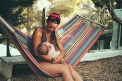 girl and baby sitting on hammock (gorbot.) Tags: leicam8 carlzeiss35mmbiogonf2zm mmount rangefinder vsco vscofilm roberta louis sicily sicilia summer