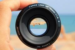 orizzonti capovolti - reversed horizons (immaginaitalia) Tags: sea sun beach girl canon lens mare liguria reversed sole spiaggia ragazza scogli horizons obiettivo orizzonti savona ceriale capovolti
