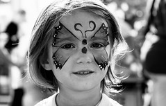 Butterfly Face (cwhitted) Tags: portrait blackandwhite bw monochrome canon eos blackwhite daughter pittsboro chathamcounty facepainted canoneos400d canoneosdigitalrebelxti canonef28135mmisusm chathamcountyfair