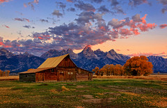 By The Dawn's Early Light (louelke - home again, will try to catch up) Tags: autumn mountains sunrise grandtetonnationalpark mormonbarn tamoultonbarn