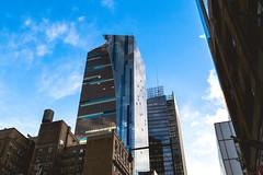 Standing Tall (Dc.Dice) Tags: new york blue sky newyork color colour reflection architecture canon buildings reflections mirror arquitectura edificios colores cielo reflejo huge reflecciones