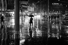 rain, rain, rain... (Cem Bayir) Tags: street leica light people blackandwhite bw monochrome night umbrella 50mm switzerland f14 summilux asph nightlive leicam asperical leicam240
