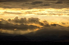 like a child, I called my mother to come see... (Alvin Harp) Tags: september 2012 sonynex5n saltlakecity sunset dramaticclouds stormysunset mountainrange oquirrhmountains goldenlight sunrays alvinharp