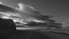 Driving into the tempest (lunaryuna) Tags: iceland northwesticeland coast coastline shoreline landscape seascape sky clouds cloudscape storm tempest weathermood road bend curve sea blackwhite bw monochrome lunaryuna