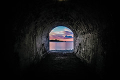 Framed Sunrise (NikNak Allen) Tags: plymouth devon devilspoint royalwilliamyard tunnel stone light morning sun sky clouds sea water coast horizon seascape pov longexposure look view frame arch