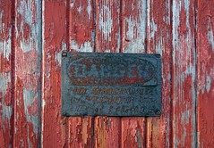 Towada Door Sign (Jae at Wits End) Tags: door hinge wood old city red urban abstract building texture abandoned broken sign metal architecture danger america writing outside handle hardware illinois rust midwest alone exterior message outdoor decay text rustic neglected entrance rusty structure minimal wear doorway forgotten american entryway worn signage oxidation lone weathered opening portal aged discarded minimalism forsaken damaged knob left simple solitary oxidize signboard alton rejected metropolitan corrosion entry decayed outcast corroded passageway dumped castaside