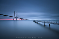 Meeting point (FredConcha) Tags: bridge sunset portugal landscape nikon lisboa lisbon lee tagus d800 pvg vascodagamabridge fredconcha