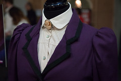Missy's costume neckline | Doctor Who Festival-106 (Paul Dykes) Tags: uk costumes england london purple brooch doctorwho missy darkwater themaster excel themagiciansapprentice thewitchsfamiliar deathinheaven doctorwhofestival