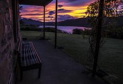 Dawn at Rhidorroch House (prajpix) Tags: dawn sunrise sunup east sky clouds silhouettes shadows rhidorroch ullapool westerross rosshire highlands scotland house seat bench verandah garden morning
