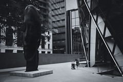 Peekaboo (Skuggzi) Tags: architecture art bw blackandwhite britain candid child city cityoflondon cultural culture england family female girl infant juxtaposition london monochrome mother parent pedestrian pushchair sculpture stroller uk unitedkingdom urban walking woman young