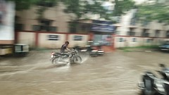 Sole rider! (Harish Kumar N) Tags: road india guy water rain season photography slush stop monsoon non chennai poring lashing thiruvanmiyur