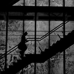 Stepping up (Leon Sammartino) Tags: white black blur monochrome silhouette stairs bag melbourne climbing fujifilm docklands xe1