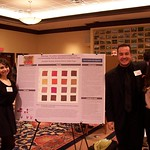 Students pose with their research poster.