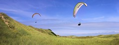 Paragliding over the Dutch mountains (B℮n) Tags: paragliding soaring schermvliegen parapenten kite vliegen fly flying bird blue sky freedom vlucht flight holland noord dune noordhollands duinreservaat wijk aan zee wijkaanzee coastline coast grass zweven vliegsporten sport parapente noordnederland thermalling lift west wind warm pilots strong winds beach sandy shore flood protection reserve north sea terrain wing take off view paragliders soarers populair dream nederland kust nature opwaardste druk lucht sand summer zoompanorama