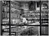 untitled (Wanderfull1) Tags: herbstore chinatown calgary downtown 2016 shopkeeper elderly man jars window working