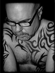 solitudal. . Lifes thoughts. (CWhatPhotos) Tags: mono monochrome black white tattoo tattooed tattoos inked tribal chest shoulders selfee me photographs selfie have it photograph pics pictures pic picture image images foto fotos photography artistic that which contain digital cwhatphotos dark portrait body upper torso tatt ink pose face look beard olympus em5 mk ii prime lens warrior curved curves bodyart ponder think decision decisions life thought thoughts