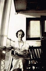 Lady On the Porch (~ Lone Wadi ~) Tags: frontporch lady outdoors house residence lostphoto retro 1940s unknown
