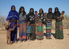 Portrait of Afar tribe women with their children, Afar region, Chifra, Ethiopia (Eric Lafforgue) Tags: afar africa africanculture africans attire chifra children colorful colourpicture colourful costume culture danakil day ethio17617 ethiopia ethiopians female fulllenght horizontal hornofafrica indigenousculture islam line lookingatcamera muslims nomadicpeople nomads outdoors pastoralists people photography portrait realpeople scarf shawl smallgroupofpeople togetherness traditional traditionalclothing traditionallifestyle tribal tribe veiled women afarregion et