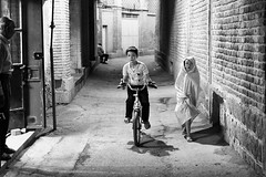 Children in alley in Shiraz, Iran (damonlynch) Tags: iran iranian middleeast middleeastern people persian places shiraz alley alleyway boy children drugabuse drugs female feminine girl health humanbeings humans issues kids lane male man masculine men person shopkeeper smoking smokingdrugs socialissue socialissues substanceabuse farsprovince