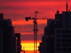 Sunset over Almaty with Construction Crane (AP4M2837 1) (Alex Panoiu) Tags: almaty kazakhstan landscape urban