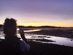 Pippa taking a photograph | Cramond. (ryanarton) Tags: uk sunset sea sky sun beach island evening scotland forth pippa cramond visitscotland