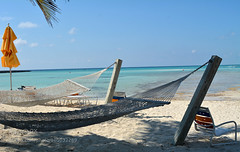 Hammocks on the beach (hammockbuddy) Tags: blue beach water umbrella chair serenity hammock torquoise 500px ifttt