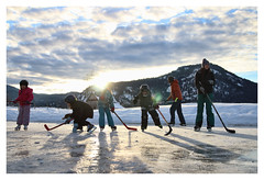 Big Whiskey Rink (༺lifemage༻) Tags: winter ice iceskating skating skate hockey outdoor ranch rural bc canada canadian sport fun game play skates sticks helmet sky clouds mountain valley rink kids family lifemage photography canon light sun shadow snow cold
