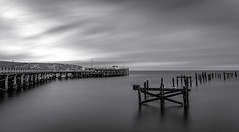 Pier old and new (Anthony White) Tags: swanage england unitedkingdom gb dorset firecrest firecrest16stops water seaside winter bnw beach clouds bw blackandwhite daytimele