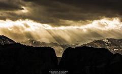 Sunbeam (Aggelos Kastoris) Tags: landscape sun silhouettes sunbeam sky magic colors black yellow outdoor mountain rocks meteora greece snow