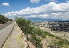 Driving to Tucson. (Tim Kiser) Tags: 2015 20151004 arizona arizonalandscape img5052 october october2015 pimacounty pimacountyarizona santacatalinamountains sentinelpeak sentinelpeakpark sentinelpeakparklandscape sentinelpeakroad sentinelpeaklandscape tucson tucsonarizona tucsonmountains tucsonmountainslandscape tucsonlandscape tucsonskyline citypark cityskyline cumulus cumulusclouds distantmountains downtowntucson downtowntucsonskyline gravel greentruck landscape ocotillo onelaneroad paloverde park parkedcars partlycloudy paved pavement redcar road roadside scenicoverlook scenicview skyline southarizona southeastarizona southeasternarizona southernarizona urbanlandscape view viewoftucson viewofacity unitedstates