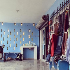 Front of a tienda. Clothes for sale and Savannah chilling. #TheWorldWalk #travel #mexico #twwphotos