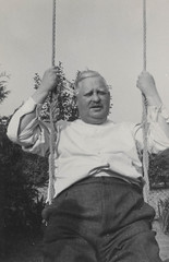 Man riding on a swing (simpleinsomnia) Tags: old white man black monochrome vintage fun found outside blackwhite funny antique snapshot rope swing moustache photograph vernacular foundphotograph