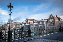 Dordrecht, The Netherlands (DC P) Tags: dordrecht netherlands taankade old street church gevel facade water city dutch canal hdr road outdoor architecture building historic historical boat boats cityscape buildings sun streetview streets streetlife stad skyline view sony a7r ii a7rii canon ef 1635 is usm metabones people photoadd the long iron bridge lange ijzeren brug spanning new harbour cast length wide designed 1855 by gn itz architect basculebrug nieuwe haven pov angle waterfront vehicle
