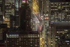 Peering between (aerojad) Tags: chicago hancockbuilding 360chicago longexposure cityscape landscape night nightphotography light streetlight lighttrails lights