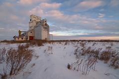 Primate pinnacle (Len Langevin) Tags: grainelevator prairie saskatchewan canada abandoned sentinel sunrise winter livingskies nikon d300s tokina 1116