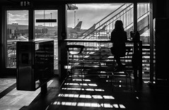 The Long Lonely Wait (Anne Worner) Tags: anneworner copenhagen denmark interior kastrup ricohgr sas airplane airport architecture backlight candid counter doors indoors purse shadowplay shadows sitting street streetphotography view windows woman silverefex