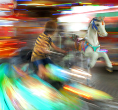 Melted Joy (TablinumCarlson) Tags: leica neuss dlux novesia nrw rheinland germany deutschland north rhinewestphalia nordrheinwestfalen streetphotography kind kid pferd horse bewegungsunschärfe kirmes funfair carnival roundabout karusell carrousel merrygoround motionblur motion bewegung farben colours freude joy boy junge merrygoroundhorse carouselhorse dlux2