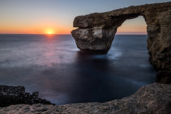 Sunset at the Azure Window - San Lawrenz, Malta - Seascape photography (Giuseppe Milo (www.pixael.com)) Tags: photo landscape sunset nature ultrawide orange rocks sun light azurewindow sky europe travel motion photography clouds malta seascape longexposure yellow cliff sea onsale