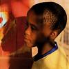 Namibie : Swakopmund (KraKote est KoKasse.) Tags: africa portrait orange jaune square southafrica rouge south couleur regard carré afrique swakopmund garcon 10faves krakote neyann necouramb forcont wwwkrakotecom ©valeriebaeriswyl