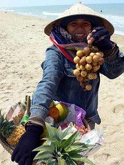lanzones anyone? (alvin pastrana) Tags: woman beach asia 2006 vietnam pineapple denim fruitvendor lanzones cuadai alvinpastrana