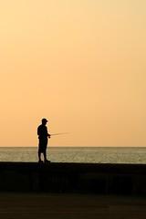 1 x 0 (let's fotografar) Tags: pordosol contraluz havana cuba pescador silhueta virtude31