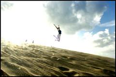 She's a solar flare. (Box of Light) Tags: sky sun fun jump sand dunes bodylanguage northcarolina geiko float orbs outerbanks obx airborn solarflare jockeysridge lastweekend feelgood reebs skypeople boxoflight gingerpower thosearealienssilhouettedbehindher boxofjump whathappensifyoushootrightintothesun