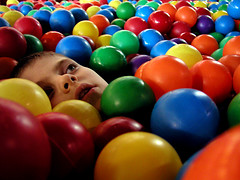 submerged (massdistraction) Tags: ballpit face catchycolors colorful child balls son 2006 eerie hidden bathed littleman flickrcentral submerged obscured glimpse littleboy indoorplayground bathedincolour plasticballs summer2006 theblinkofaneye