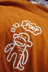 "Sock Monkeys Think ""Poop"" (Jodi K.) Tags: orange tshirt 2006 poop sockmonkey comiccon sdcc sandiegocomiccon sappymoosetree poopreport"