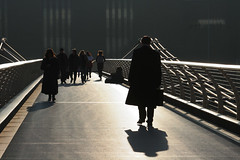 Millennium Bridge march (Lil [Kristen Elsby]) Tags: uk bridge light shadow london silhouette museum architecture footbridge unitedkingdom tate millenniumbridge tatemodern getty topv4444 topf100 gettyimages bankside privateworlds gettyimagesonflickr