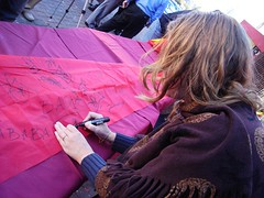 Betsy signing a Chinese banner