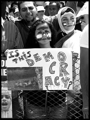 Is This Democracy (danny.hammontree) Tags: blackandwhite bw lebanon usa art march israel washingtondc washington bush districtofcolumbia nikon war peace unitedstates iran god palestine flag muslim georgewbush fear faith georgebush politics iraq whitehouse rally religion protest d2x middleeast photojournalism saturday august 2006 christian demonstration arab antiwar violence jew jewish zionism judaism antibush nikkor fascism beirut lafayettepark israeli activist liban violent  palestinian occupation orthodoxjews waronterror marches rallies coexist  hammontree digitalgrace nikond2x  peacemovement dannyhammontree wwwdigitalgracecom warsucks  sfchronicle96hours freelebanon       20060812