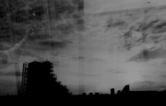 Holding on to (slona) Tags: sky blackandwhite clouds 35mm doubleexposure cage scs tmax100 byker explored holdingonto contax137maquartz
